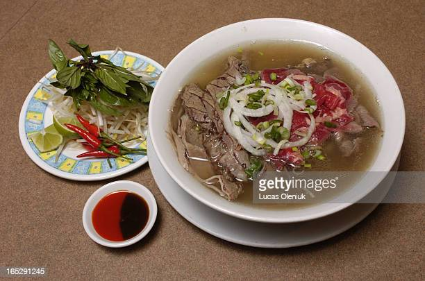 Rare and welldone beef slices in noodle soup with green onions and beef broth from ChoLon Vietnamese resteraunt in Markham For Sunday Brunch feature...