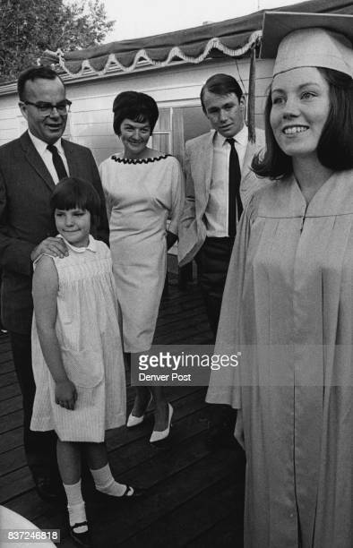 Rare Day in McVicker FamilyEverybody's Together Rep Roy McVicker in glasses is home for daughter Theresa's graduation from Wheat Ridge High School...