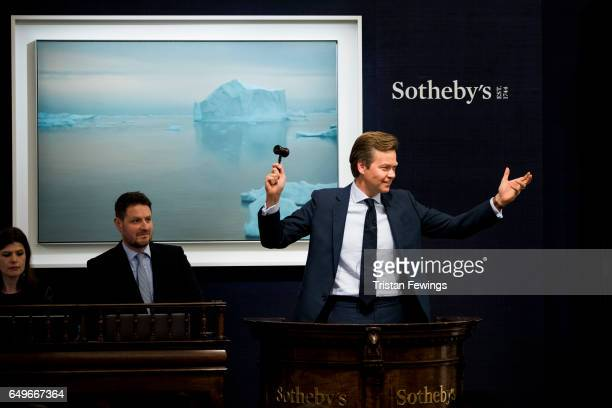 A rare iceberg painting by the world's topselling living painter Gerhard Richter sold for £177 million at Sotheby's on March 8 2017 in London England...