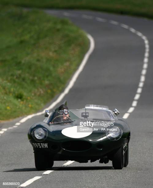 A rare Jaguar Dtype one raced by motor racing legend Mike Hawthorn takes a special test drive near Eastbourne in Sussex to mark the opening of a...