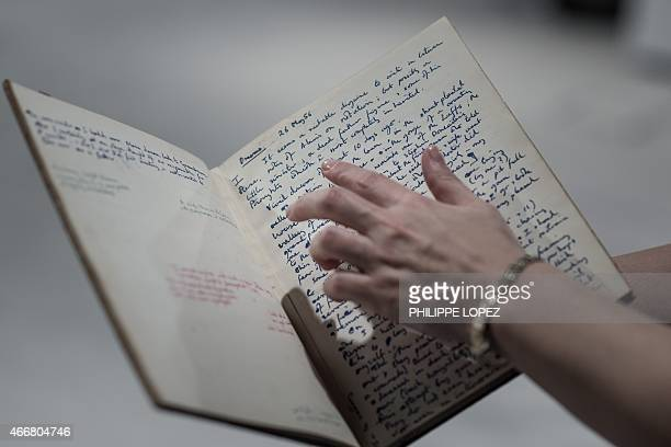 A rare manuscript belonging to British mathematician and code breaker Alan Turing is shown in Hong Kong on March 19 2015 The handwritten notebook...