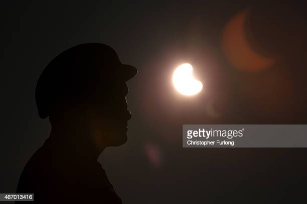 A rare partial solar eclipse is seen over the Miner's Family Statue in Tonypandy in South Wales on March 20 2015 in Tonypandy Wales United Kingdom...