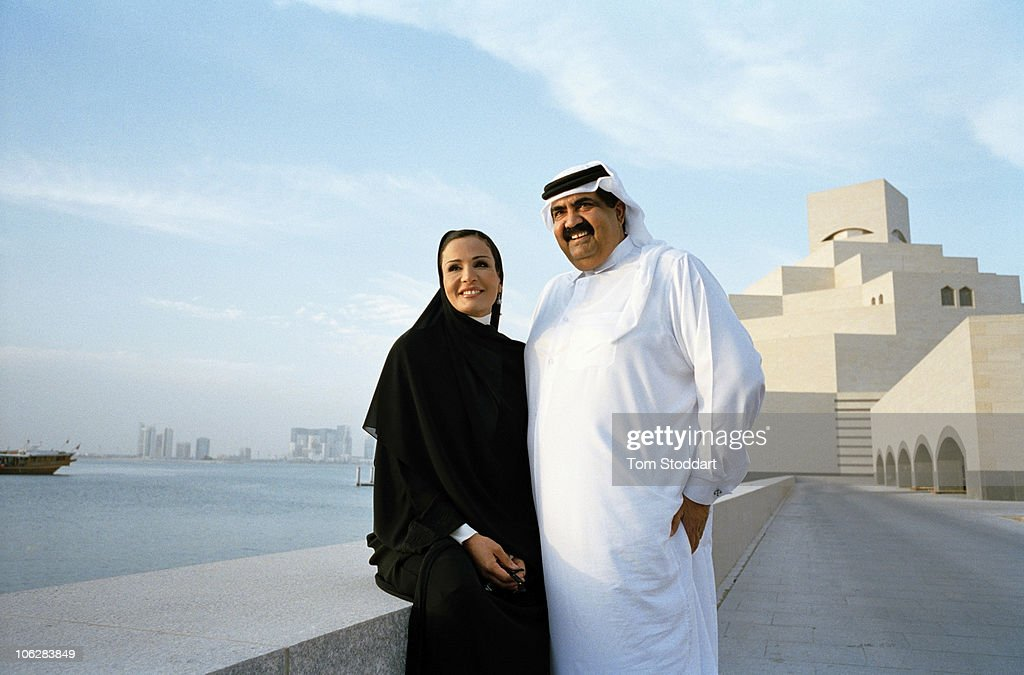 A rare portrait of His Highness the Emir Sheikh Hamad bin Khalifa Al-Thani together with his wife Sheikha Mozah bint Nasser al-Missned outside the new Museum of Islamic Art in Doha, Qatar. The country's huge oil and gas reserves have made it one of the world's richest economies and has fuelled booming development.