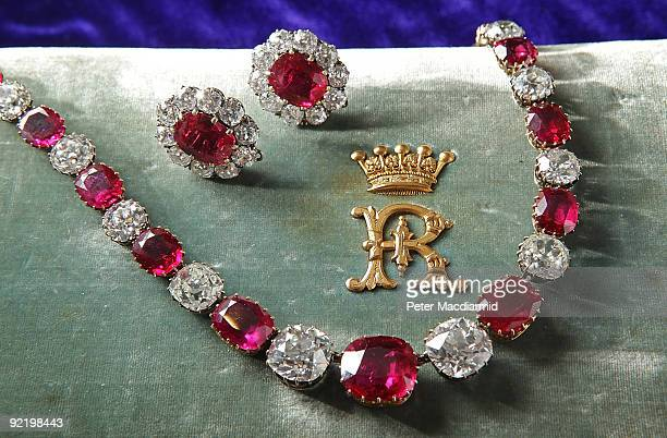 A rare ruby and diamond necklace and ruby earings from the 19th Century are displayed at Sotheby's on October 22 2009 in London England Property of...