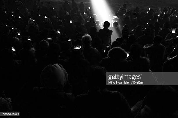 Rare View Of Crowd Photographing Performance On Street At Night