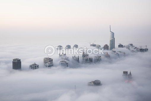 Rare winter morning fog blanketing Dubai skyscrapers. : Foto de stock