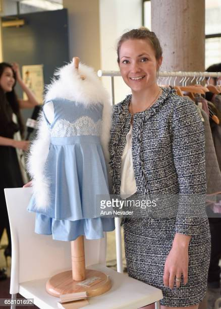 Rarity designer Beverly Card in a blue double flounce party dress at Vancouver Fashion Week Fall/Winter 2017 at Chinese Cultural Centre of Greater...