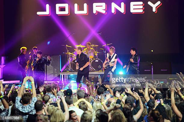 Rascal Flatts perform with Journey onstage at the 2012 CMT Music awards at the Bridgestone Arena on June 6 2012 in Nashville Tennessee