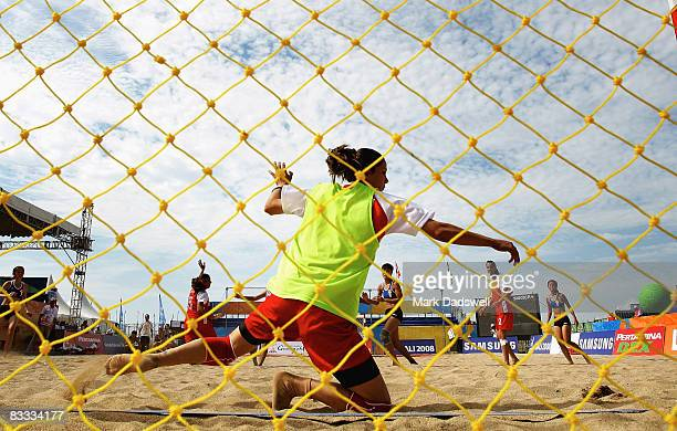 Rasha Obeidat of Jordan is beaten in the goalmouth by a shot from the Hong Kong China team in the Womens Beach Handball on day one of the 2008 Asian...