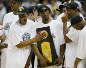 Rashad Anderson and Ben Gordon of the UConn Huskies celebrate with the trophy after defeating the Georgia Tech Yellow Jackets 8273 during the...