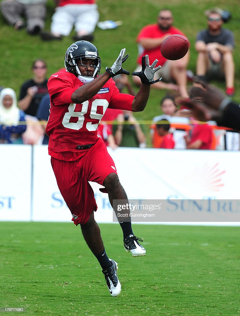 Rashad Evans #89 of the Atlanta Falcons makes a catch during practice against the Cincinnati Bengals at the Atlanta Falcons Training Complex on August 6 2013 in Flowery Branch, Georgia.