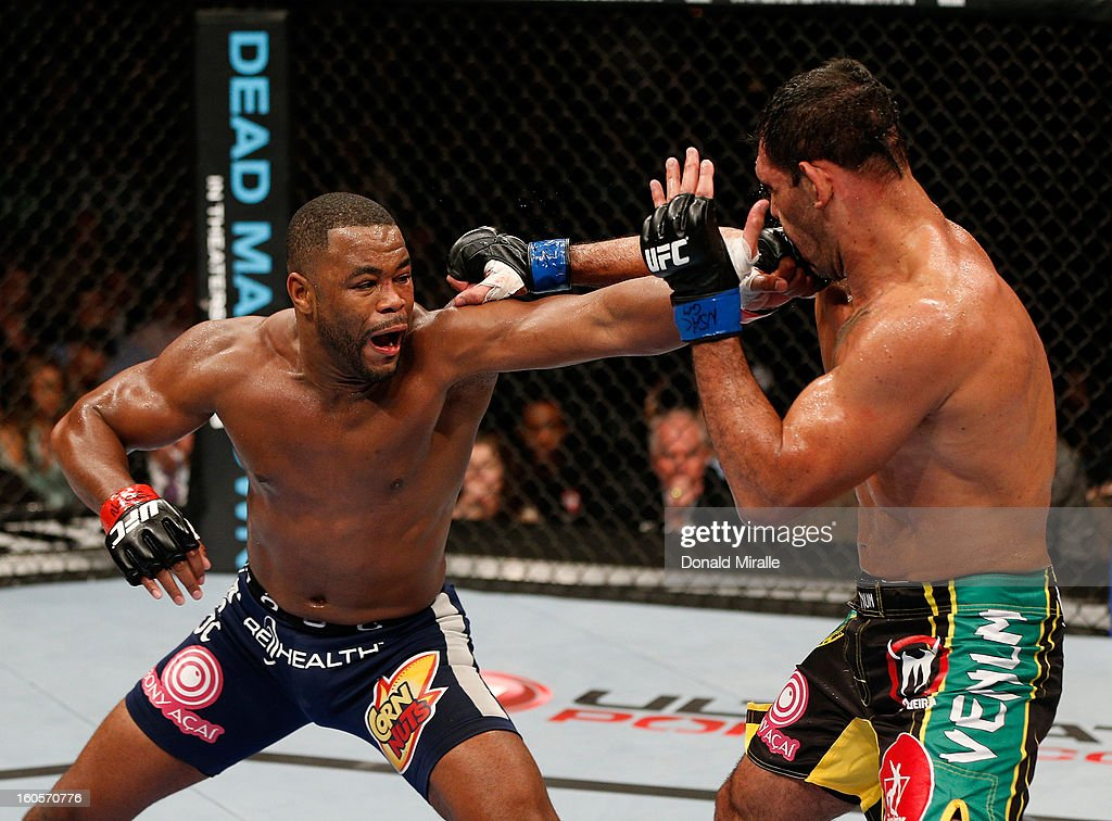 <a gi-track='captionPersonalityLinkClicked' href=/galleries/search?phrase=Rashad+Evans&family=editorial&specificpeople=2312276 ng-click='$event.stopPropagation()'>Rashad Evans</a> punches Antonio Rogerio Nogueira during their light heavyweight fight at UFC 156 on February 2, 2013 at the Mandalay Bay Events Center in Las Vegas, Nevada.