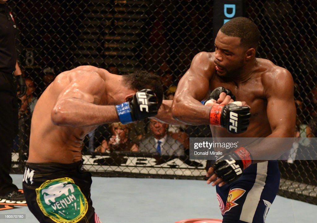 Rashad Evans punches Antonio Rogerio Nogueira during their light heavyweight fight at UFC 156 on February 2, 2013 at the Mandalay Bay Events Center in Las Vegas, Nevada.