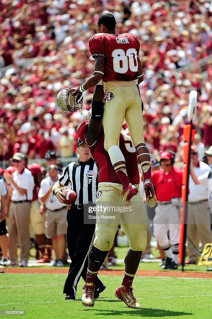 Rashad Greene and Cameron Erving of the Florida State Seminoles celebrate a punt return during a game against the Wake Forest Demon Deacons at Doak...