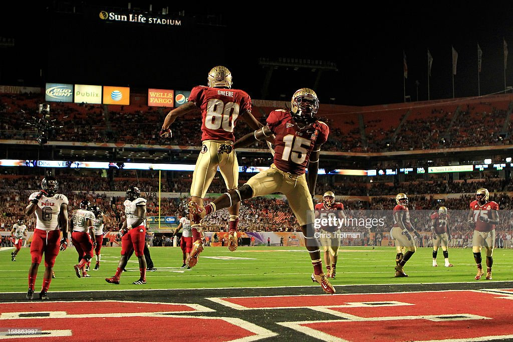 Rashad Greene #80 and Greg Dent #15 of the Florida State Seminoles celebrate after Greene scored a 6-yard touchdown reception in the second quarter against the Northern Illinois Huskies during the Discover Orange Bowl at Sun Life Stadium on January 1, 2013 in Miami Gardens, Florida.