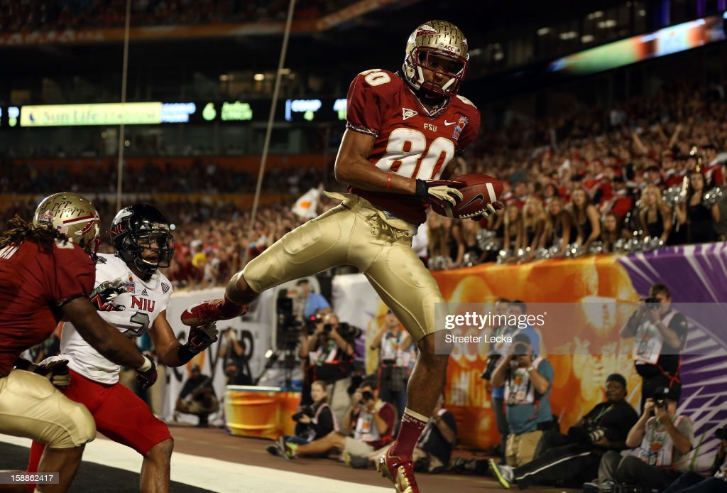Rashad Greene #80 of the Florida State Seminoles catches a 6-yard touchdown reception in the second quarter against the Northern Illinois Huskies during the Discover Orange Bowl at Sun Life Stadium on January 1, 2013 in Miami Gardens, Florida.