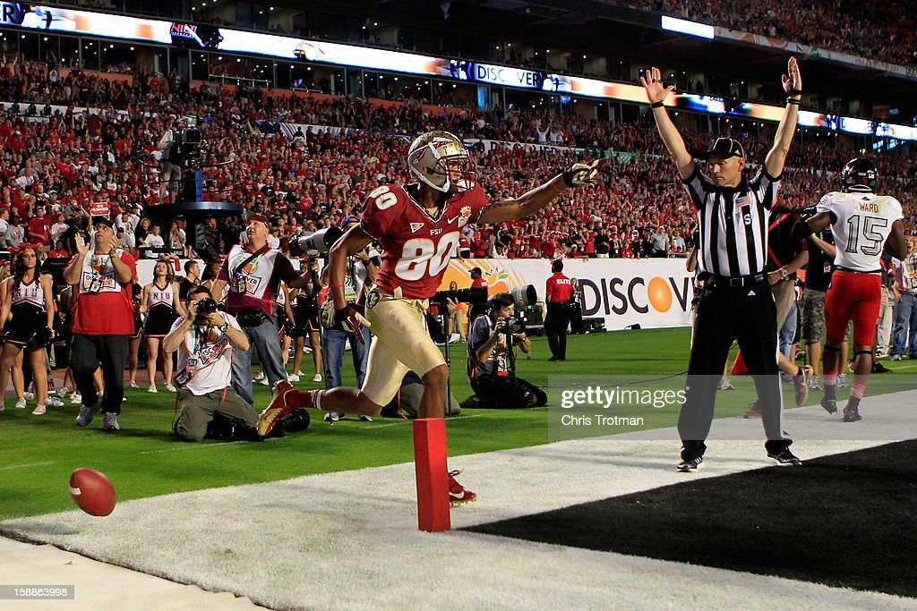 Rashad Greene #80 of the Florida State Seminoles celebrates after he scored a 6-yard touchdown reception in the second quarter against the Northern Illinois Huskies during the Discover Orange Bowl at Sun Life Stadium on January 1, 2013 in Miami Gardens, Florida.