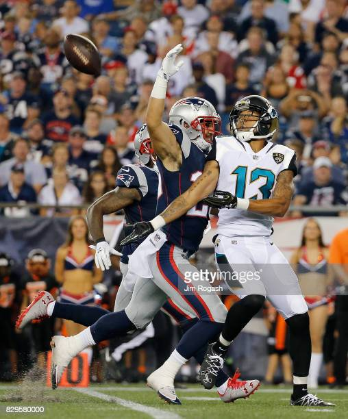 Rashad Greene of the Jacksonville Jaguars is unable to catch the football as Jason Thompson of the New England Patriots draws an interference call in...