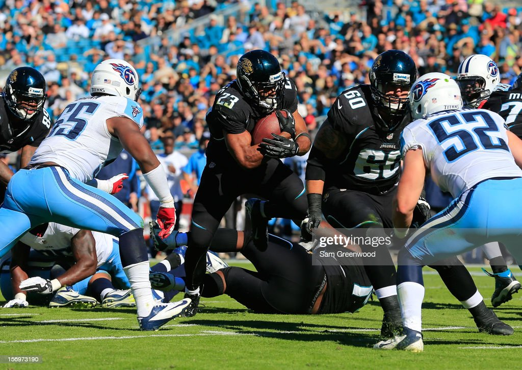 <a gi-track='captionPersonalityLinkClicked' href=/galleries/search?phrase=Rashad+Jennings&family=editorial&specificpeople=2250821 ng-click='$event.stopPropagation()'>Rashad Jennings</a> #23 of the Jacksonville Jaguars rushes for yardage during the game against the Tennessee Titans at EverBank Field on November 25, 2012 in Jacksonville, Florida.