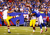 Rashad Jennings of the New York Giants blocks the punt of Tress Way of the Washington Redskins in the first quarter at MetLife Stadium on September...