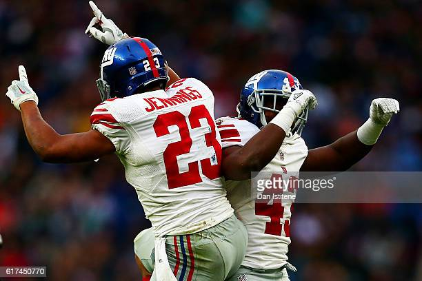 Rashad Jennings of the New York Giants celebrates with Bobby Rainey of the New York Giants after scoring a touchdown during the NFL International...