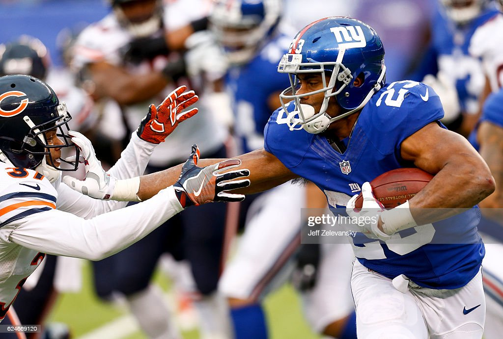 Rashad Jennings #23 of the New York Giants holds off Bryce Callahan #37 of the Chicago Bears during their game at MetLife Stadium on November 20, 2016 in East Rutherford, New Jersey.