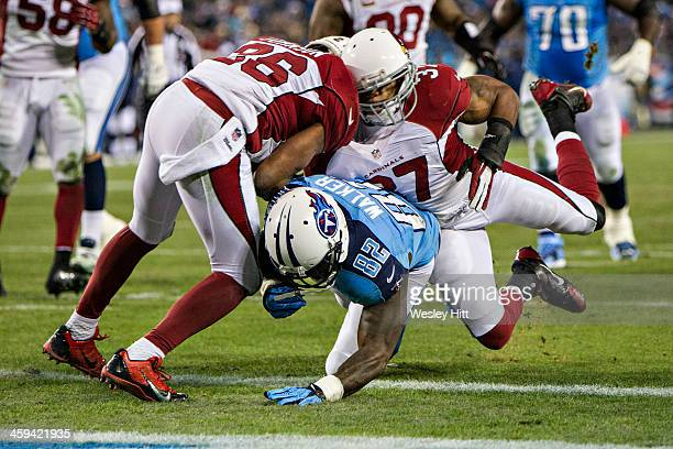 Rashad Johnson and Yeremiah Bell collide while trying to tackle Delanie Walker of the Tennessee Titans at LP Field on December 15 2013 in Nashville...