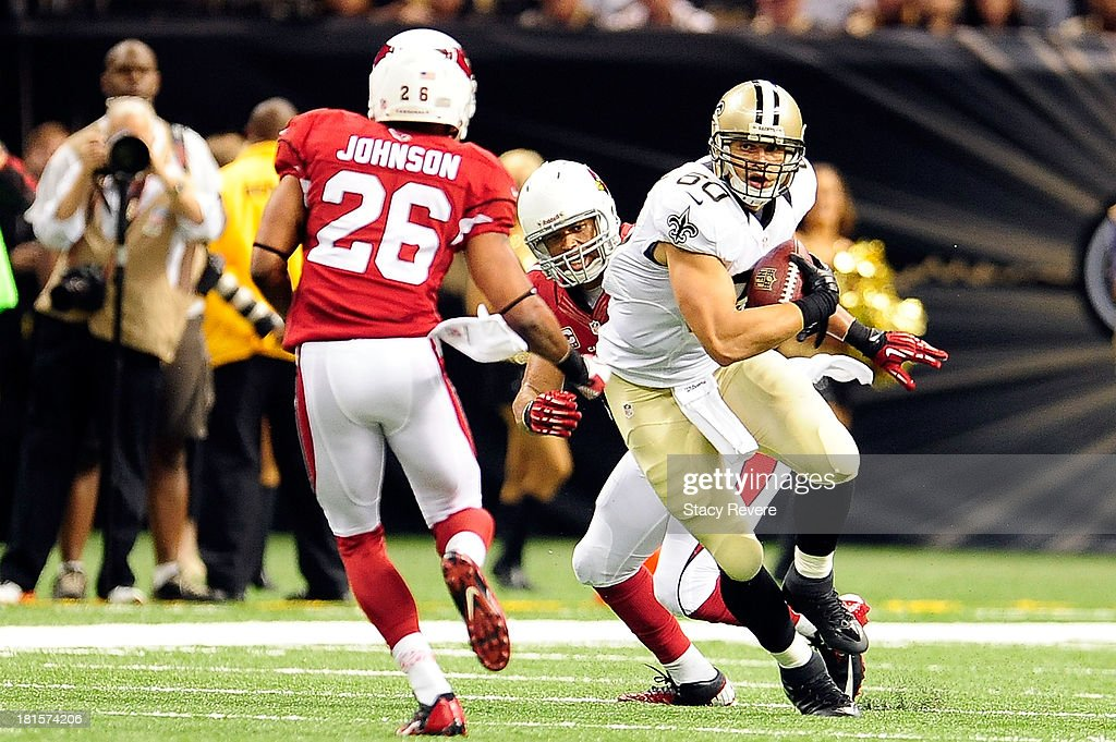 Rashad Johnson #26 of the Arizona Cardinals prepares to tackle Jimmy Graham #80 of the New Orleans Saints during a game at the Mercedes-Benz Superdome on September 22, 2013 in New Orleans, Louisiana. The Saints defeated the Cardinals 31-7.