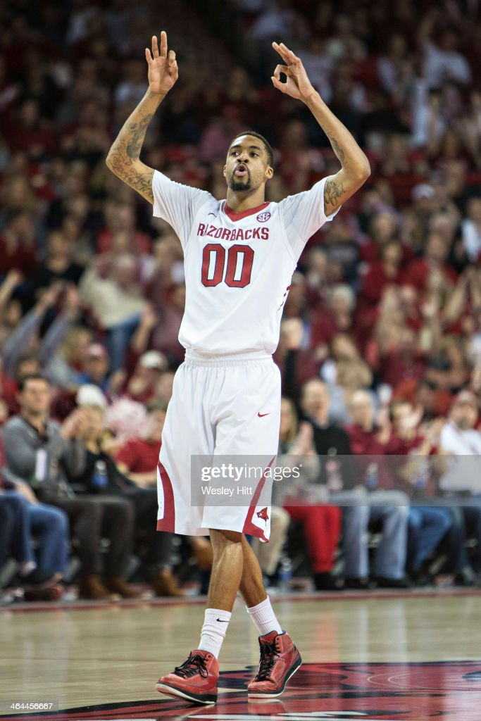 Rashad Madden #00 of the Arkansas Razorbacks celebrates after making a three point basket against the Florida Gators at Bud Walton Arena on January 11, 2014 in Fayetteville, Arkansas. The Gators defeated the Razorbacks 84-82.