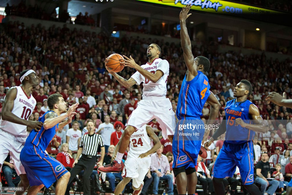 Rashad Madden of the Arkansas Razorbacks drives to the basket against the Florida Gators at Bud Walton Arena on January 11, 2014 in Fayetteville, Arkansas. The Gators defeated the Razorbacks 84-82.