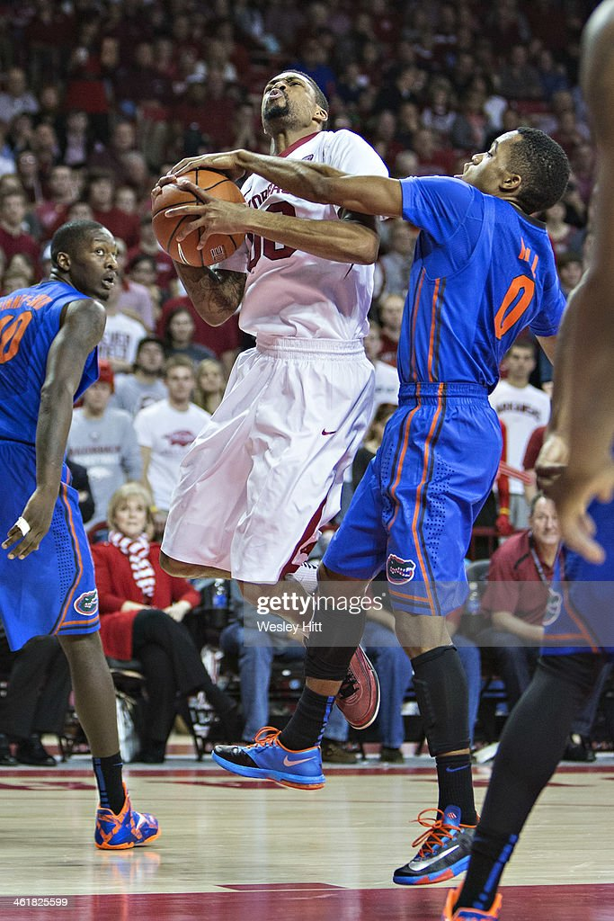 Rashad Madden #00 of the Arkansas Razorbacks has his shot blocked by <a gi-track='captionPersonalityLinkClicked' href=/galleries/search?phrase=Kasey+Hill&family=editorial&specificpeople=5417565 ng-click='$event.stopPropagation()'>Kasey Hill</a> #0 of the Florida Gators at Bud Walton Arena on January 11, 2014 in Fayetteville, Arkansas. The Gators defeated the Razorbacks 84-82.