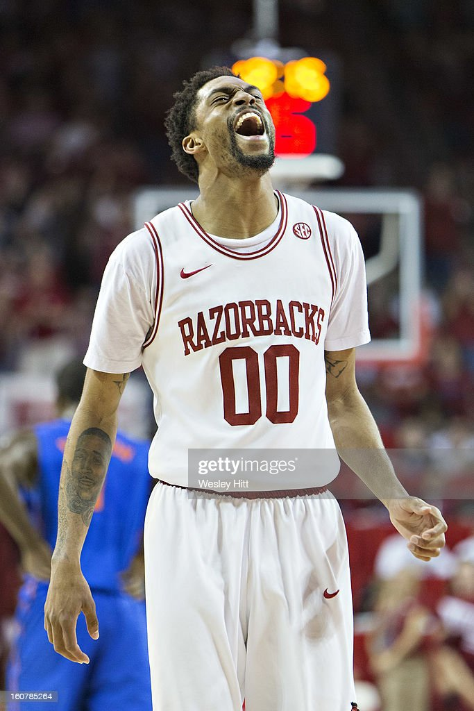 Rashad Madden #00 of the Arkansas Razorbacks yells in excitement during a game against the Florida Gators at Bud Walton Arena on February 5, 2013 in Fayetteville, Arkansas. The Razorbacks defeated the Gators 80-69.