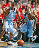 Rashad McCants and Raymond Felton pursue a loose ball during the second half of the Tar Heels 9168 victory over the Davdison Wildcats