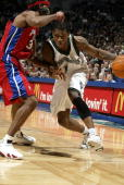 Rashad McCants of the Minnesota Timberwolves drives to the basket around Richard Hamilton of the Detroit Pistons on January 24 2006 at the Target...