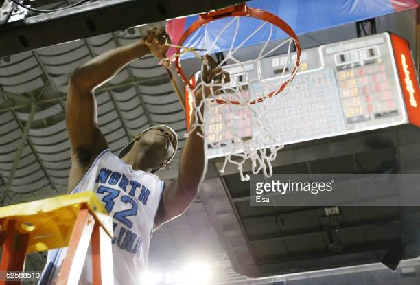 Rashad McCants of the North Carolina Tar Heels celebrates by cutting down the nets after defeating the Illinois Fighting Illini 7570 to win the NCAA...