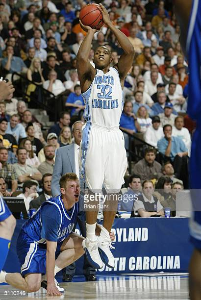 Rashad McCants of the North Carolina Tar Heels shoots over Nick Welch of the Air Force Falcons during their first round game of the NCAA Division I...