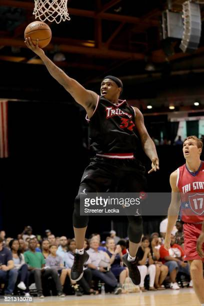 Rashad McCants of Trilogy attempts a shot past Lou Amundson of TriState during week five of the BIG3 three on three basketball league at UIC Pavilion...