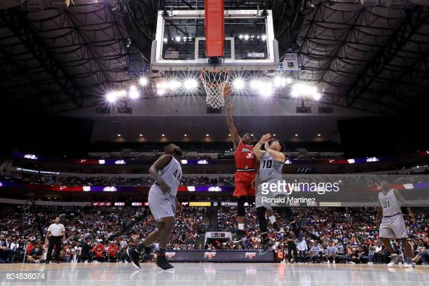 Rashad McCants of Trilogy attempts a shot while being guarded by Mike Bibby of the Ghost Ballers during week six of the BIG3 three on three...