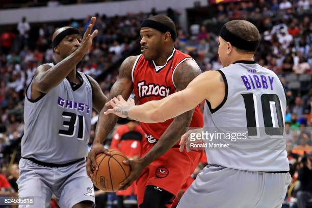 Rashad McCants of Trilogy dribbles the ball between Ricky Davis and Mike Bibby of the Ghost Ballers during week six of the BIG3 three on three...