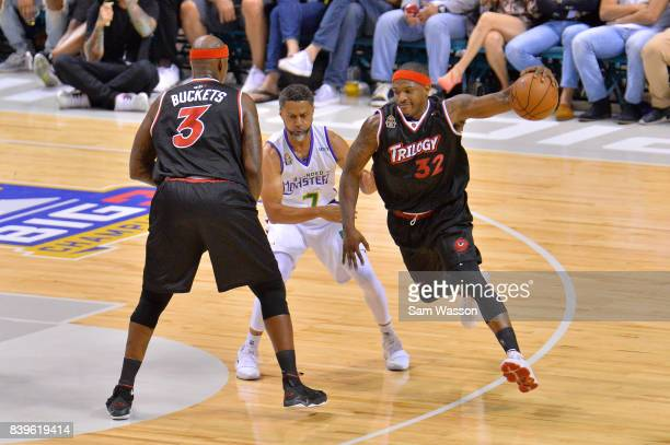Rashad McCants of Trilogy drives with the ball against Mahmoud AbdulRauf of 3 Headed Monsters during the BIG3 three on three basketball league...