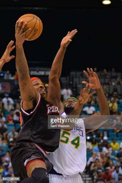 Rashad McCants of Trilogy goes up for a shot against Kwame Brown of 3 Headed Monsters during the BIG3 three on three basketball league championship...