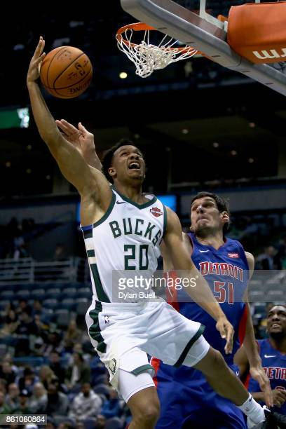 Rashad Vaughn of the Milwaukee Bucks attempts a shot while being guarded by Boban Marjanovic of the Detroit Pistons in the first quarter during a...
