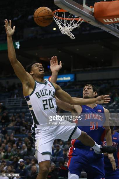Rashad Vaughn of the Milwaukee Bucks attempts a shot while being guarded by Boban Marjanovic of the Detroit Pistons in the second quarter during a...