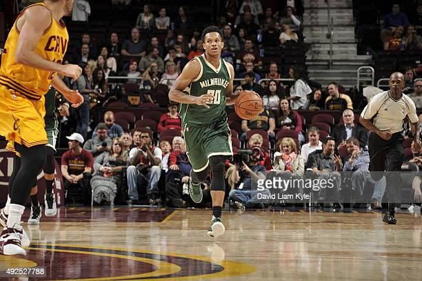 Rashad Vaughn of the Milwaukee Bucks brings the ball up court against the Cleveland Cavaliers on October 13 2015 at Quicken Loans Arena in Cleveland...