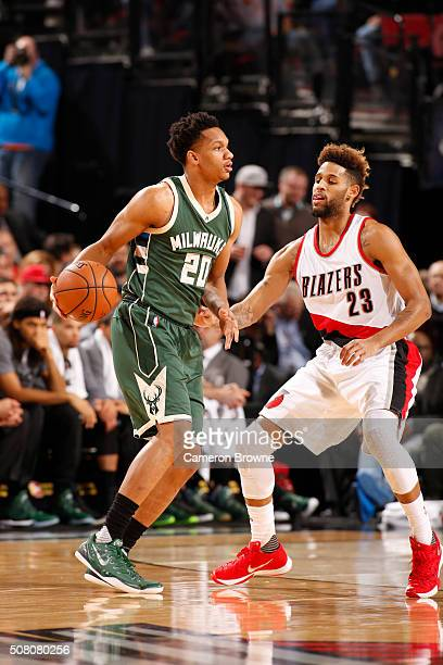 Rashad Vaughn of the Milwaukee Bucks defends the ball against Allen Crabbe of the Portland Trail Blazers during the game on February 2 2016 at Moda...