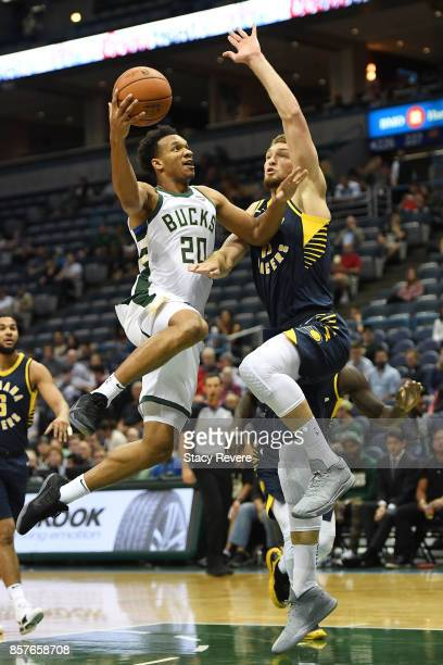 Rashad Vaughn of the Milwaukee Bucks drives to the basket against Domantas Sabonis of the Indiana Pacers during the first half of a preseason game at...
