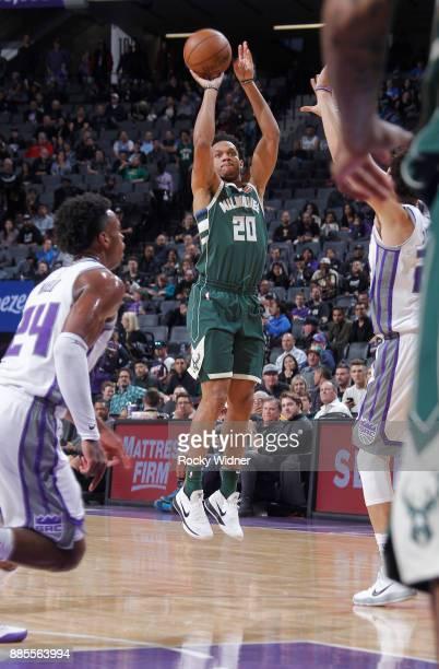 Rashad Vaughn of the Milwaukee Bucks shoots a three pointer against the Sacramento Kings on November 28 2017 at Golden 1 Center in Sacramento...