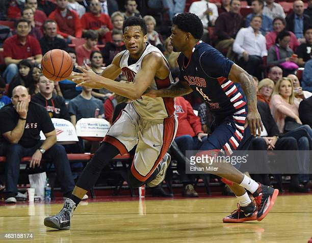 Rashad Vaughn of the UNLV Rebels drives against Julien Lewis of the Fresno State Bulldogs during their game at the Thomas Mack Center on February 10...