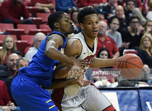 Rashad Vaughn of the UNLV Rebels drives against Miguel Dicent of the Morehead State Eagles during their game at the Thomas Mack Center on November 14...