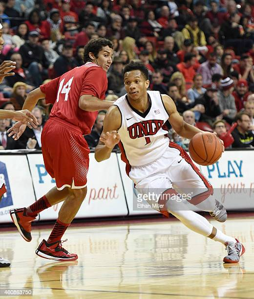 Rashad Vaughn of the UNLV Rebels drives past James McGee of the Southern Utah Thunderbirds during their game at the Thomas Mack Center on December 27...